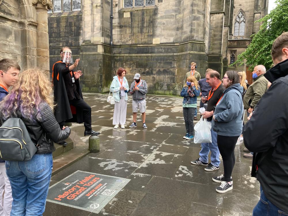 Tour group social distancing in Edinburgh Scotland