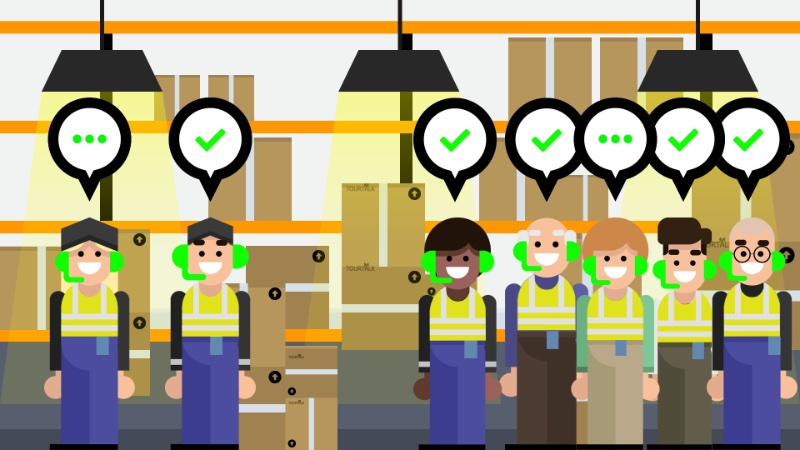Tour guides with visitors on a factory tour using a tour guide system